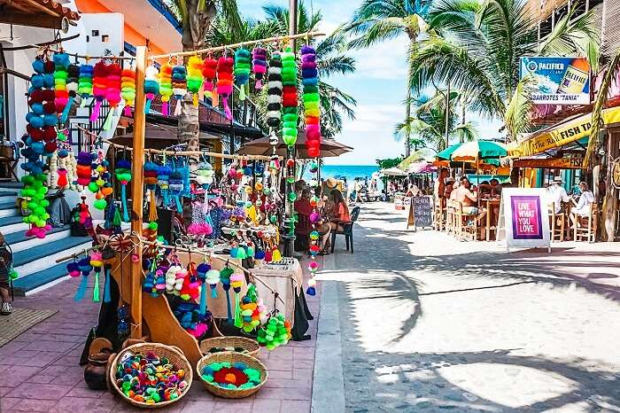 A colorful market area with roadside dining options at Sayulita