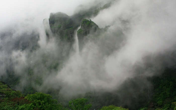 mountain peaks covered by mists
