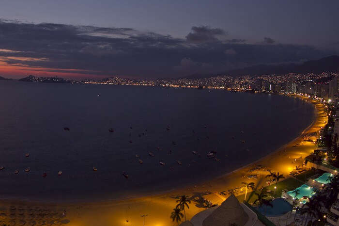 A huge bay of hotels stretching along the coast in Acapulco