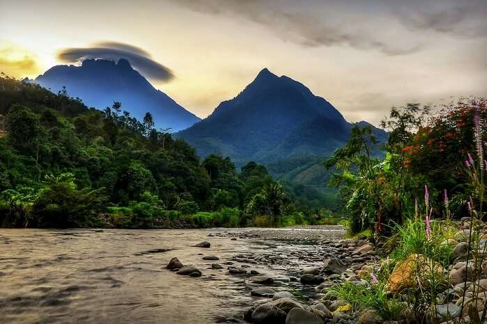 A view of Kinabalu Mountain in the background of the village Of Tambatuon in Borneo district of Sabah with an amazing rare cloud formation on the top of it