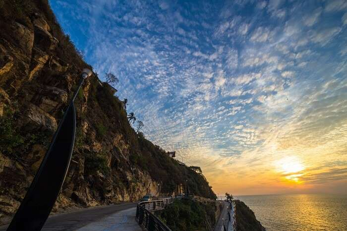 A sunset shot of a road by the coast at Acapulco