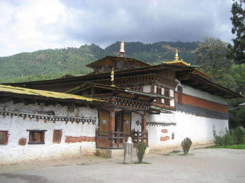 an old monastery with golden decoration in Bhutan