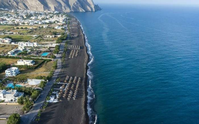 Aerial version of Perissa Black Sand Beach