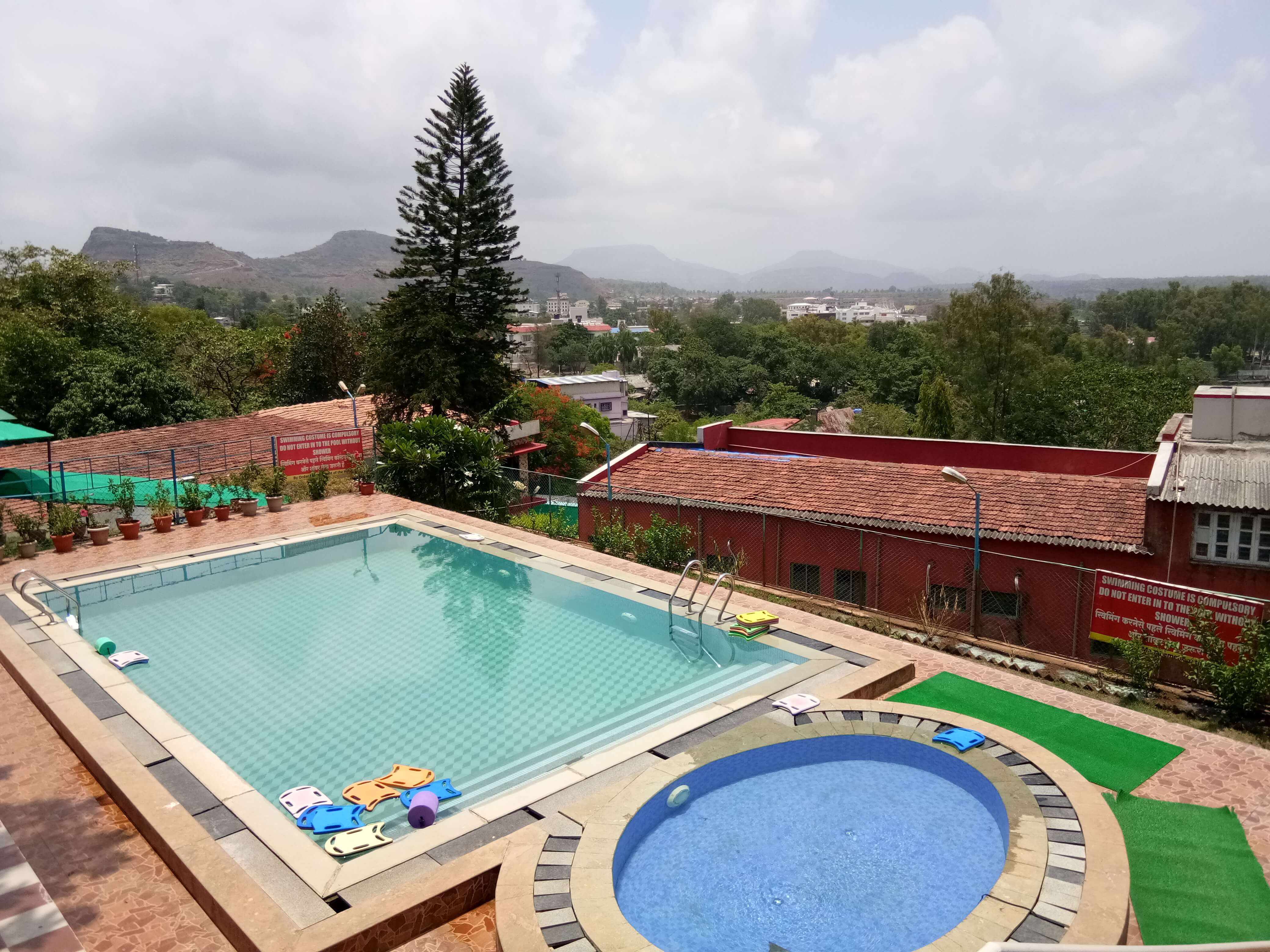 two outdoor pools in a resort in Saputara
