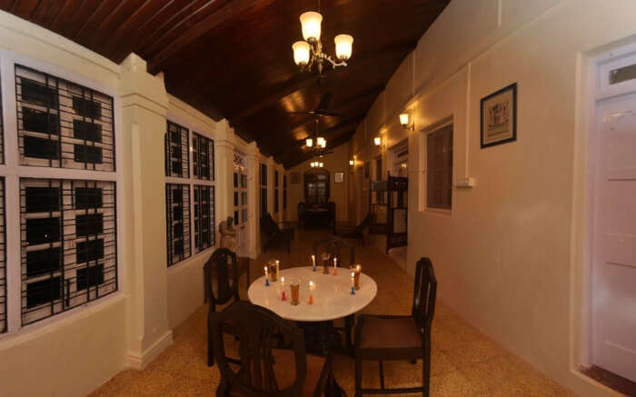 Corridor of a colonial style resort with a table and chairs