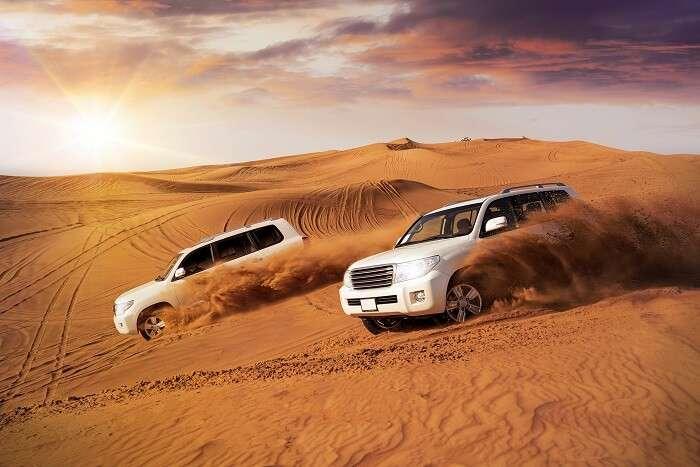 go dune bashing during desert safari
