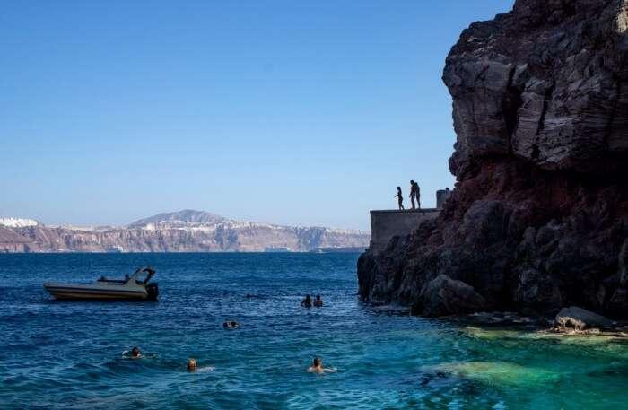 cliff jumping at Amoudi Bay