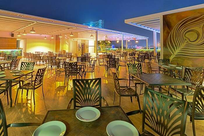 A night shot of the rooftop restaurant of Hotel Chenthur Park in Coimbatore