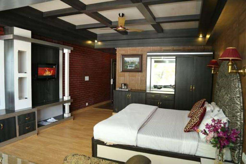 A hotel room with stylish wooden work