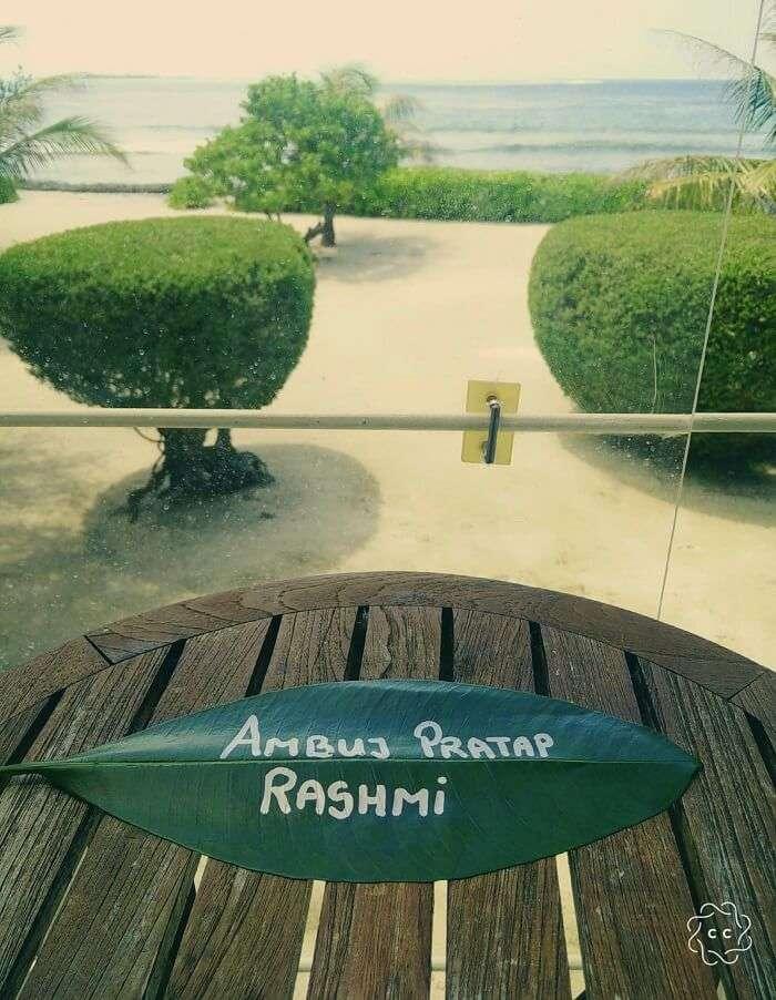 ambuj rashmi name on leaf with a view of maldives sea