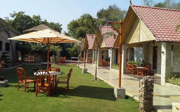 Lawn seating arrangement at Kamdhenu Resort in Vadodara