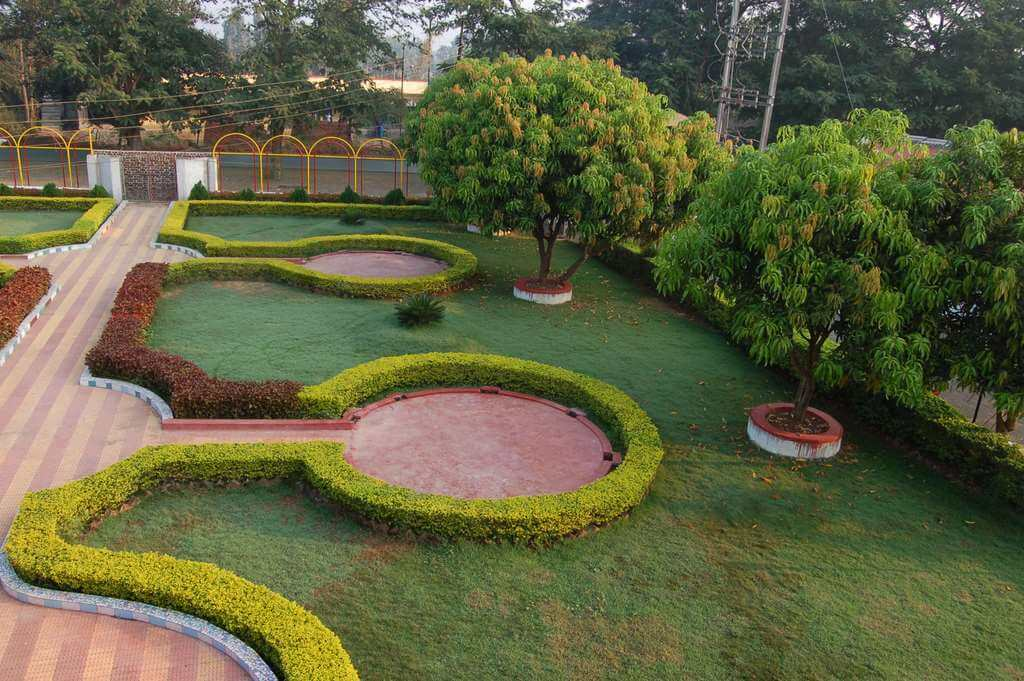 a beautifully manicured garden in a resort