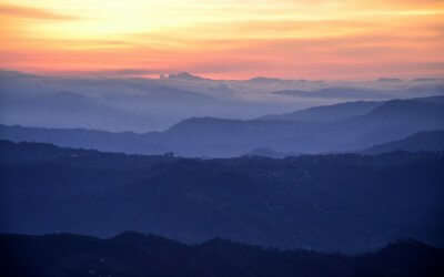 Orange sky after sunset in the mountains