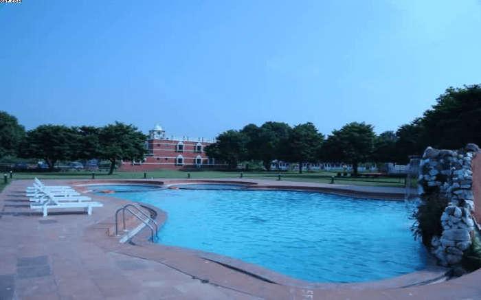 Poolside view of Aum Health Resort in Vadodara
