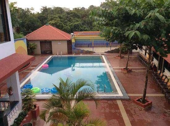 a huge pool inside a resort
