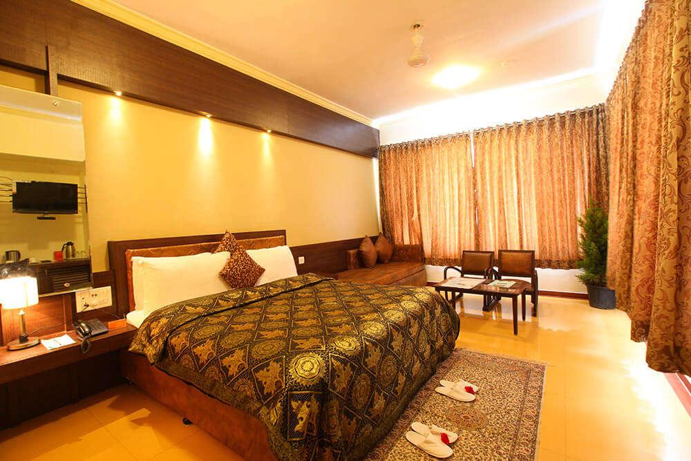 a beautiful bedroom of a resort