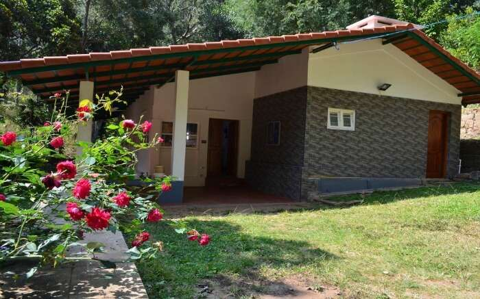 Side view and from the gardens of Water Rock Bungalow in Yercaud