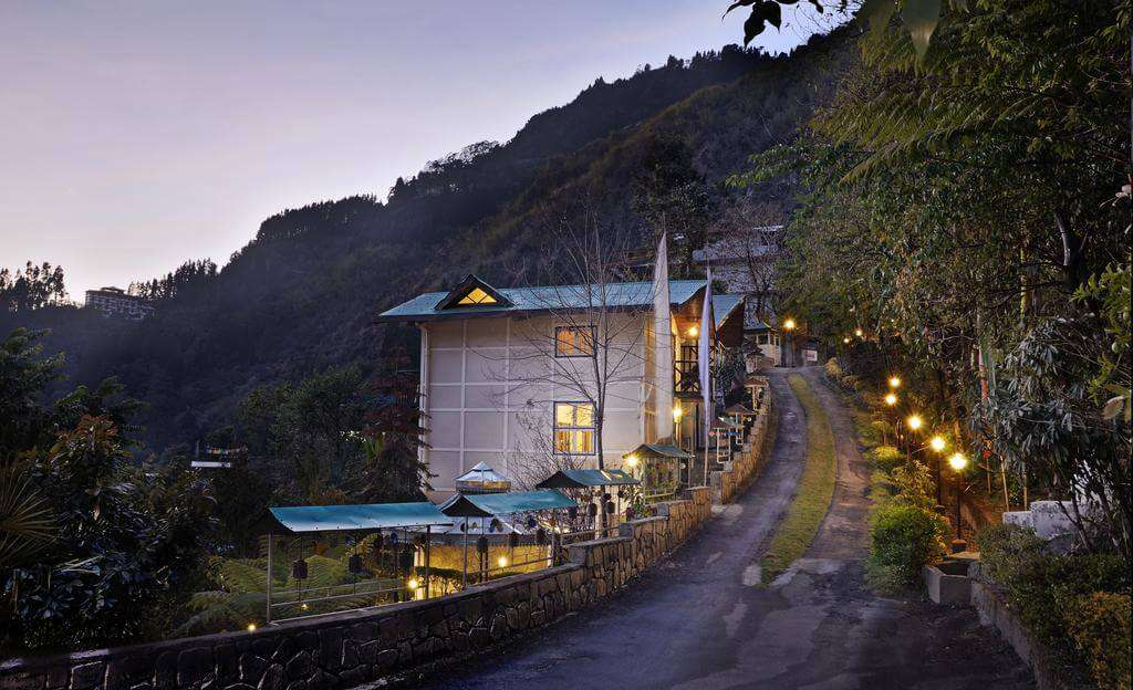 a resort near road in mountains