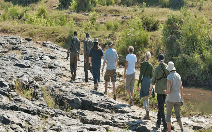 Travelers taking walking through the Nyalaland Wilderness Trail in Kruger