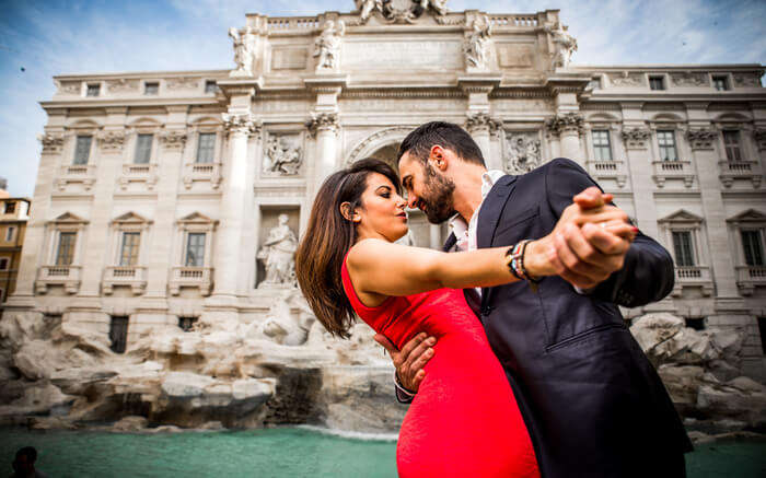 A couple in front of Trevi Fountain in Rome