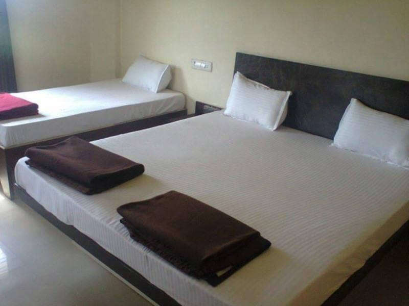 two bed with white cover with black blanket