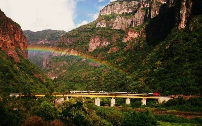 An El Chepe train cutting through the canyon in Mexico