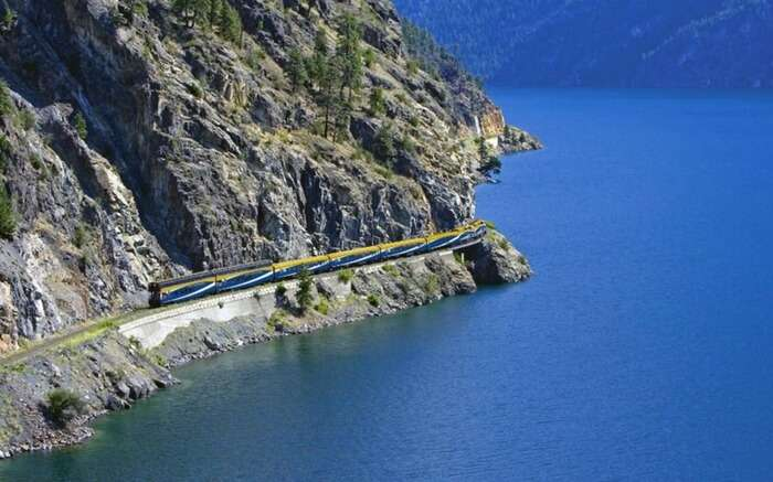 A Rocky Mountaineer by the mountain in Canada