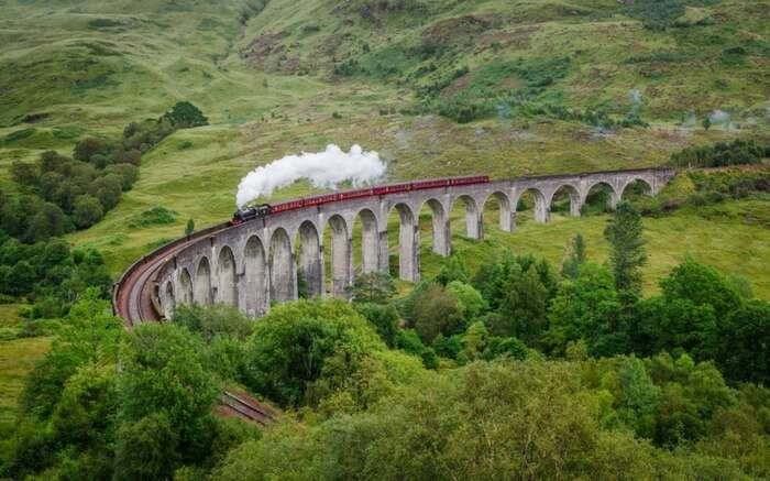 The West Highland Line crossing Glenfinnan Viaduct in Scotland
