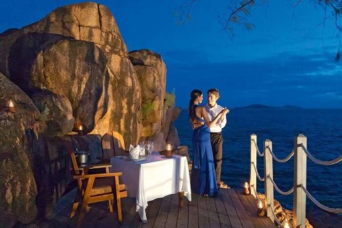 A couple enjoying a private dinner at the Beach Bar and Grill at Constance Lemuria resort in Seychelles