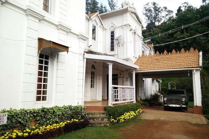 A car in the drive-in of the Marlborough House in Ooty