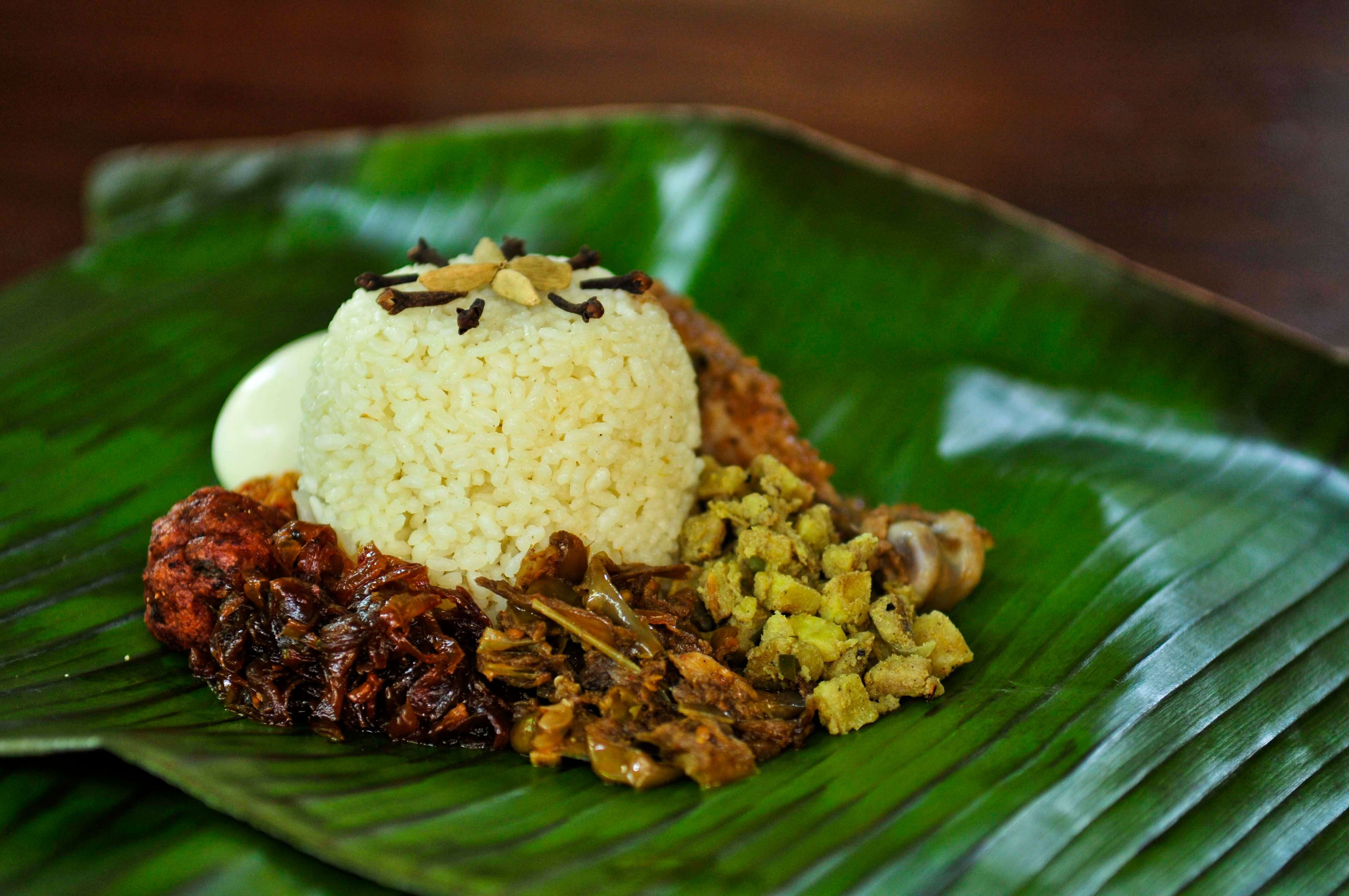 rice and meat on a banana leaf