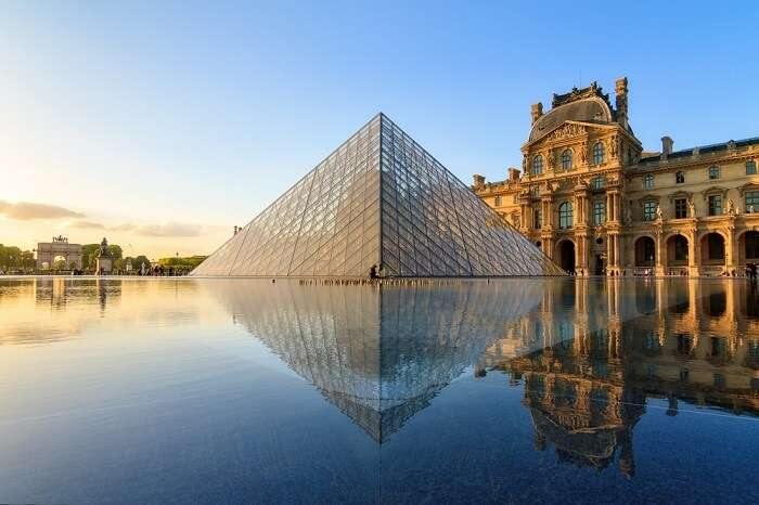 The Louvre museum pyramid at sunset in Paris