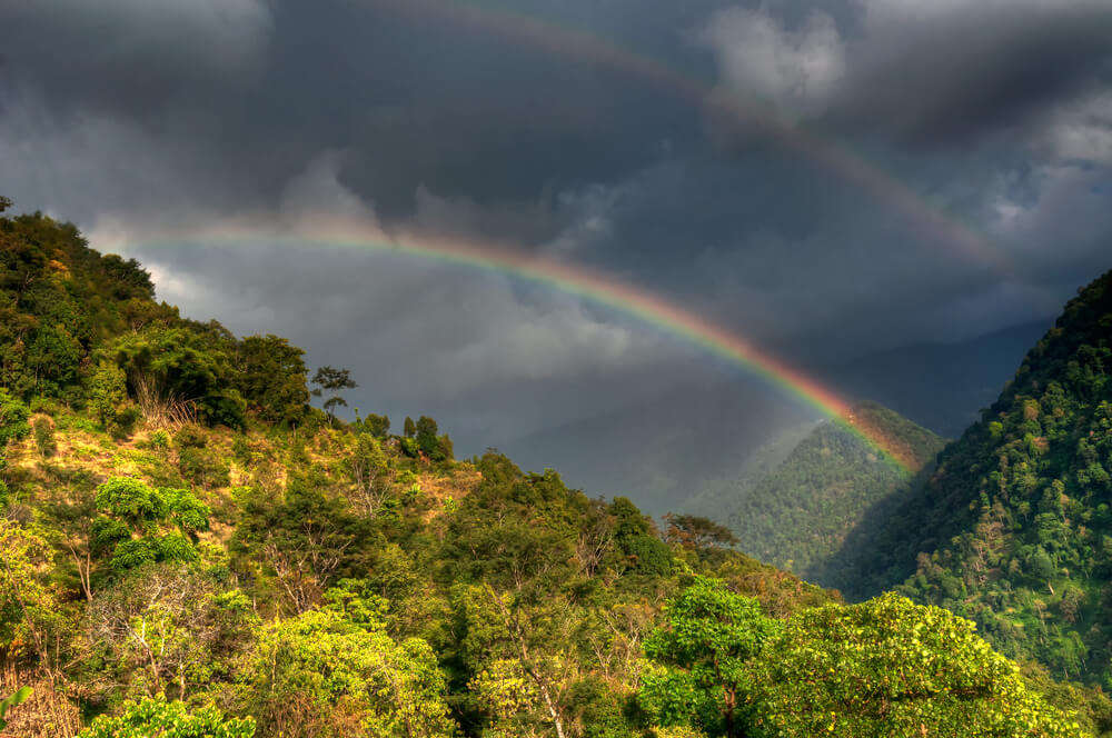 a beautiful rainbow over mountains
