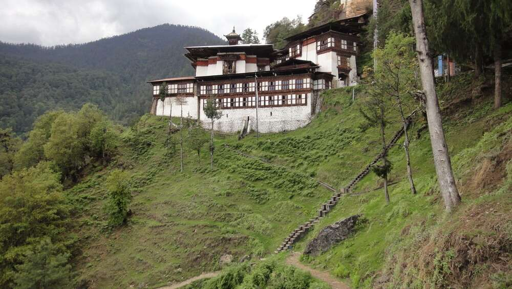 a monastery by a hillside