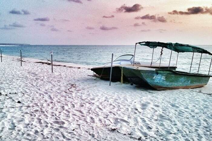 Two boats on the white sands of Kadmat Beach