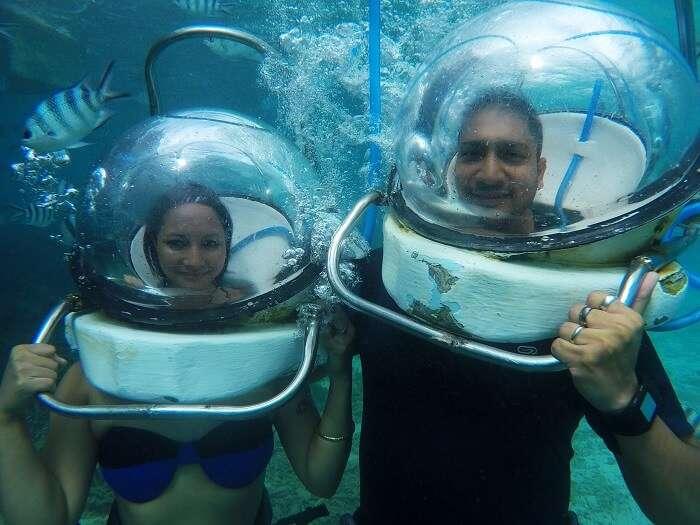couple enjoys underwater seawalking