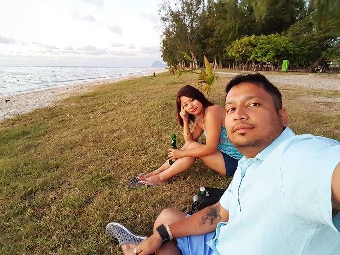 Couple relaxing near the beach