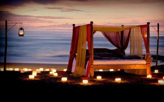 A romantic dinner setup by the sea beach in Canggu