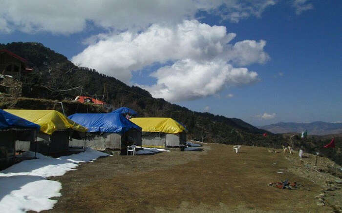 Camps in mountains with yellow and blue roof