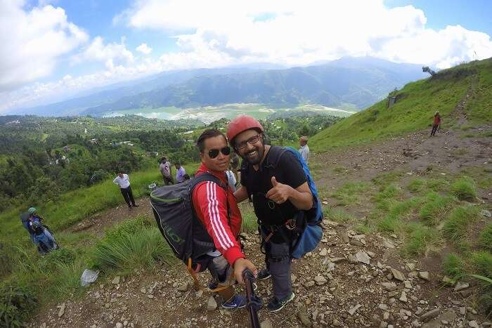 narayan and his paragliding guide in nepal