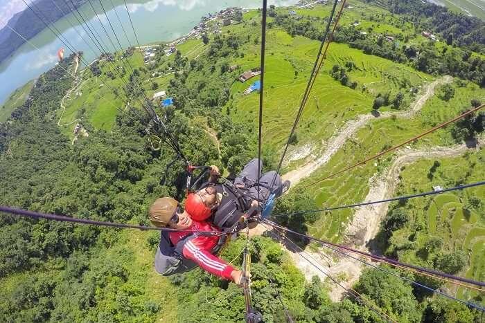 narayan enjoying paragliding in nepal