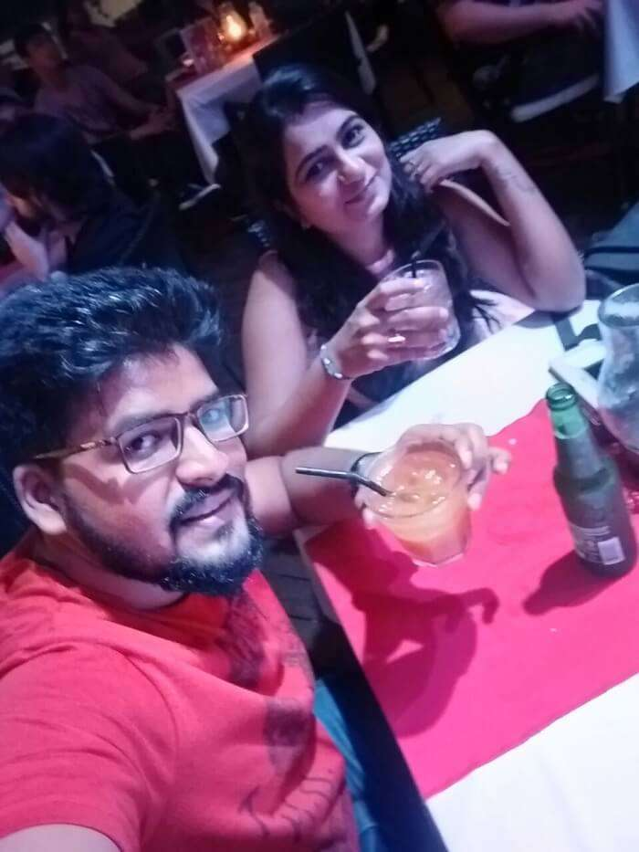 nirav & wife enjoying drinks at rock bar in bali