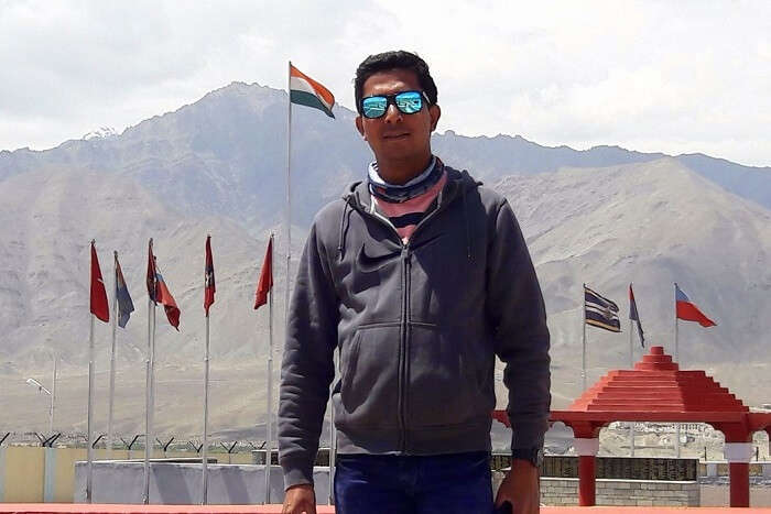 ninad posing outside war memorial ladakh