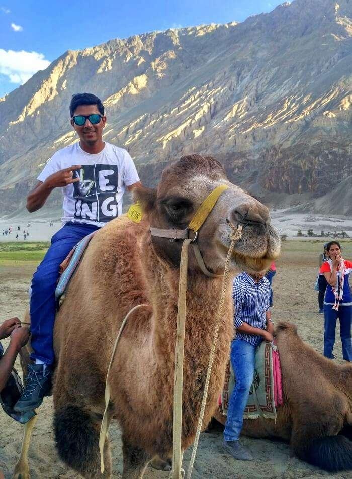 ninad riding camel in nubra