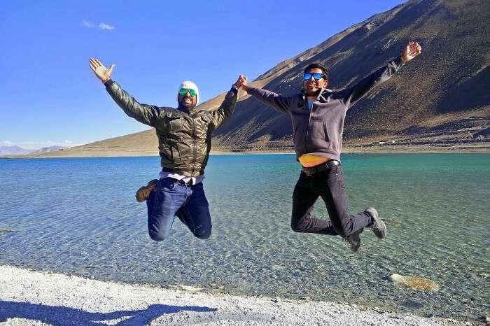 ninad and friend jumping near pangong lake
