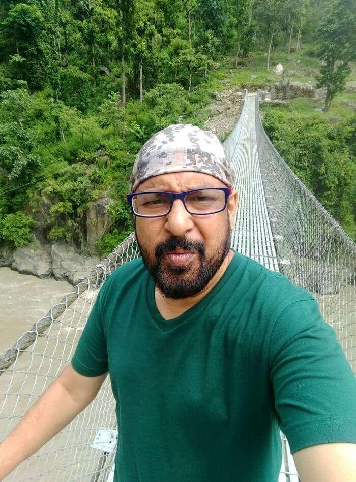 narayan taking selfie on bridge on his nepal trip