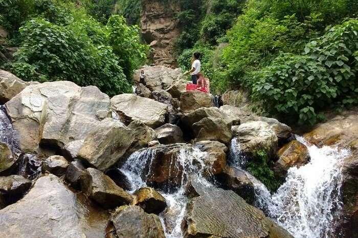 narayan checking out davis falls in nepal