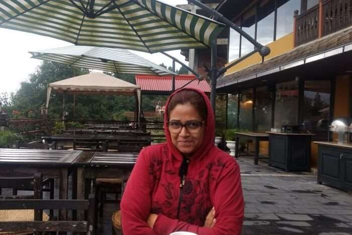 narayan's wife sitting at cafe in hotel country villa