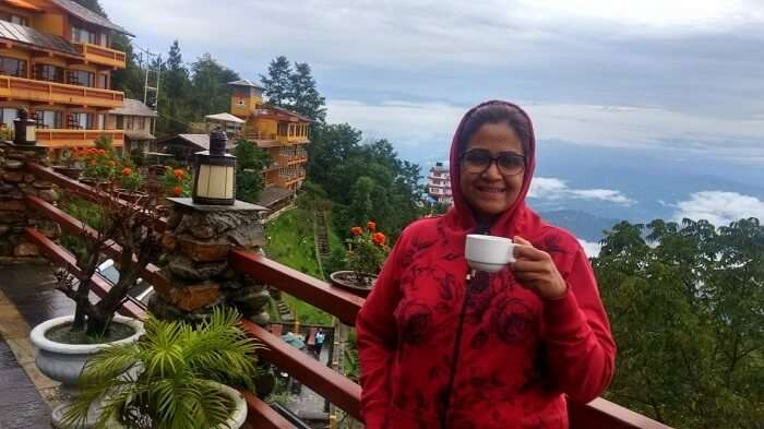 narayan's wife having tea before splendid views from hotel country villa