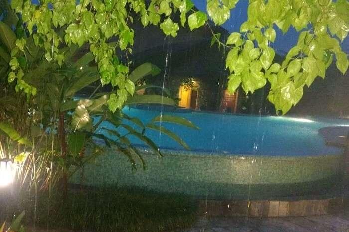 narayan enjoying time at swimming pool at temple tree resort in pokhara